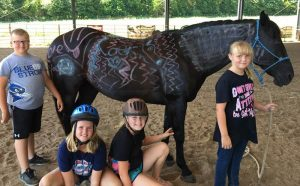 Group horseback riding lesson with Chalkboard the horse
